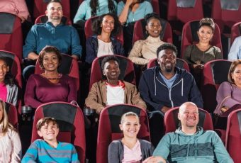 multi-ethnic-audience-watching-movie-in-theater-istock-969306030