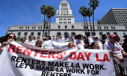 Some 200 low-income renters and their supporters shout slogans while gathered on the steps to City Hall in downtown Los Angeles on April 20, 2016, where attention was called to the increasing burden of rising rents and threats of eviction, ahead of a City Council Housing Committee meeting. / AFP / FREDERIC J. BROWN        (Photo credit should read FREDERIC J. BROWN/AFP/Getty Images)
