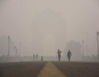 People walk near India gate amid heavy smog in New Delhi. According to doctors, the extreme pollution in the city could aggravate the ongoing COVID-19 coronavirus situation in the city.Ê (Photo by Manish Rajput / SOPA Images/Sipa USA)(Sipa via AP Images)